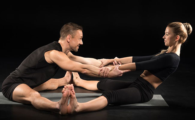 Partner Forward Fold yogasana