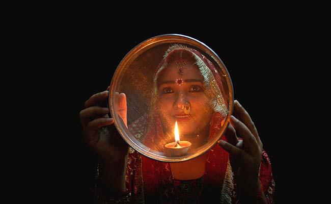 Woman Praying on Karwa Chauth