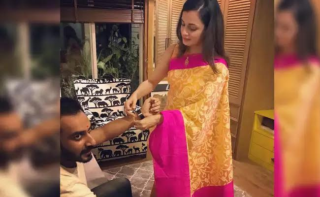 Dia Mirza Tying Rakhi To Brother-In-Law