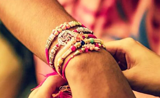 Sisters Tying Rakhi to Each Other