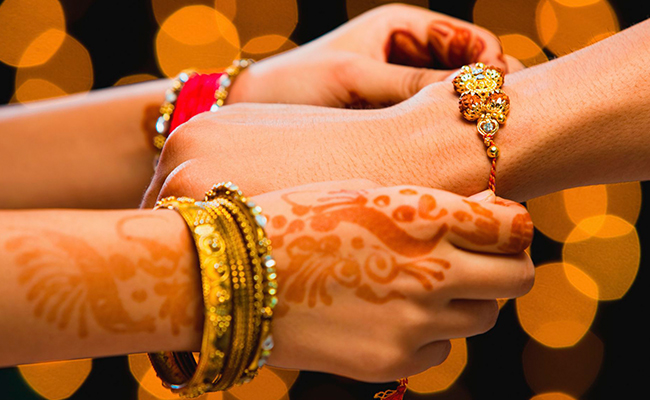Tying Rakhi to Husband