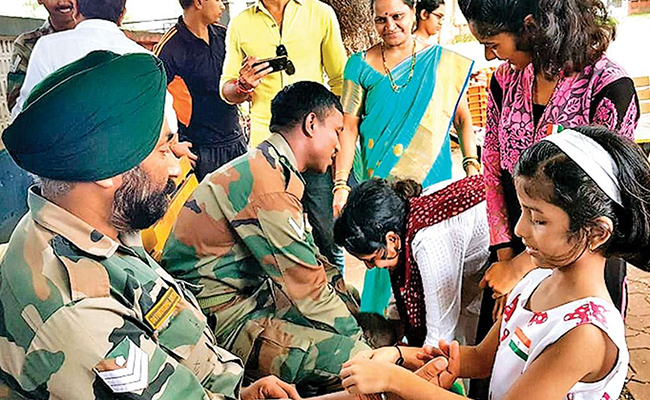 Girls Tying Rakhi to Indian Army Soldiers