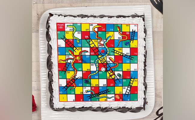Snakes and ladders poster cake