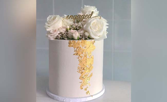 Touch of gold engagement cake