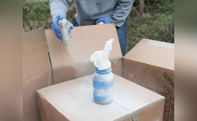 painting bottles with spray paint