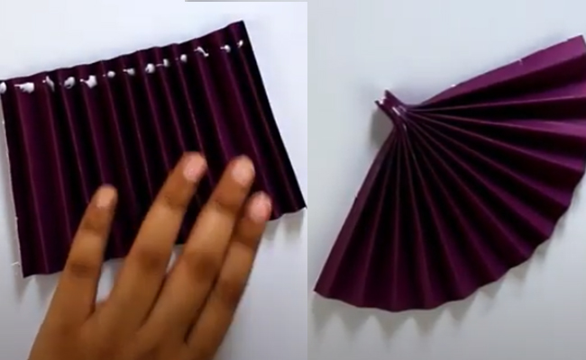 Fold the paper by hand from once inside and the other time outside
